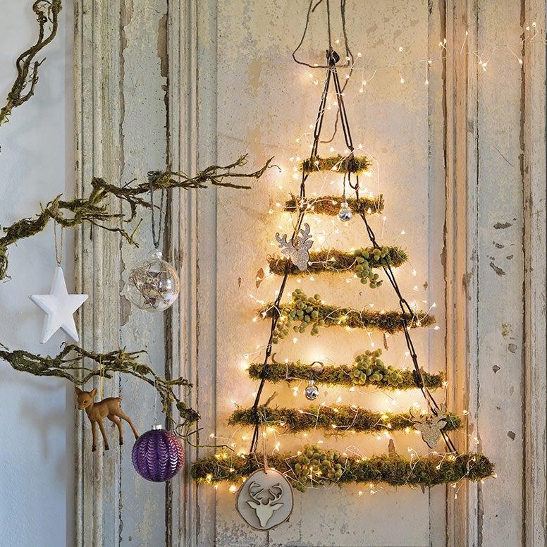 Alternatieve kerstboom van houten stokken