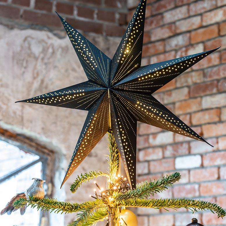 Kerstboom versieren, stap 2: de piek